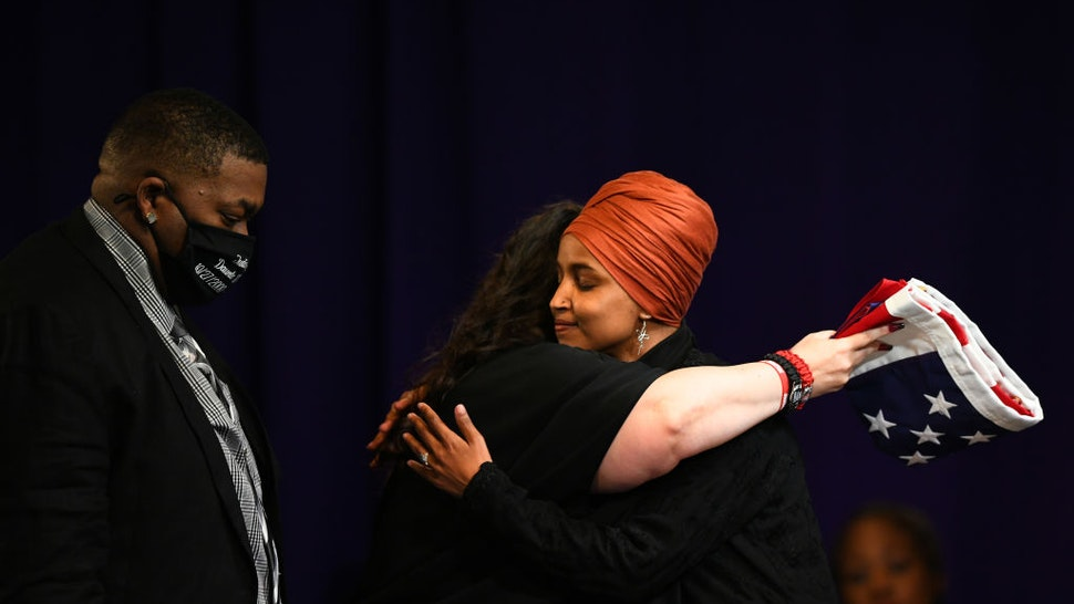 Father Aubrey Wright and mother Katie Wright are presented a flag by U.S. Rep Ilhan Omar (D-MN) during a funeral held for Daunte Wright at Shiloh Temple International Ministries on April 22, 2021 in Minneapolis, Minnesota. Daunte Wright was shot and killed by police during a traffic stop in Brooklyn Center, Minnesota on April 11 which sparked days of protests.