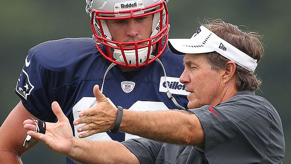 Foxborough-07/26/12. The New England Patriots held their first open practice at the practice field at Gillette Stadium. Coach Bill Belichick gives some pointers to Jake Bequette. Boston Globe staff Photo by John Tlumacki(sports)