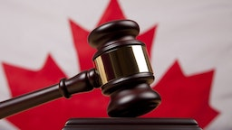 Gavel In Front Of Canadian Flag