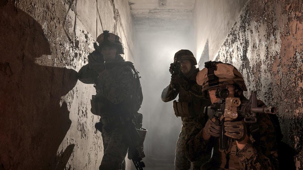 Three U.S. Marines involved in the raid. - stock photo
