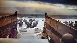 "Digitally colorized image of ""Into the Jaws of Death"", a photograph by Robert F Sargent of the United States Army First Infantry Division disembarking from an LCVP (landing craft) onto Omaha Beach during the Normandy Landings on D Day during World War 2, June 6, 1944. (Photo via Smith Collection/Gado/Getty Images)."