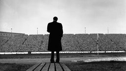 The American evangelist Billy Graham addresses a huge crowd at half time in a match between Chelsea and Newcastle at Stamford Bridge