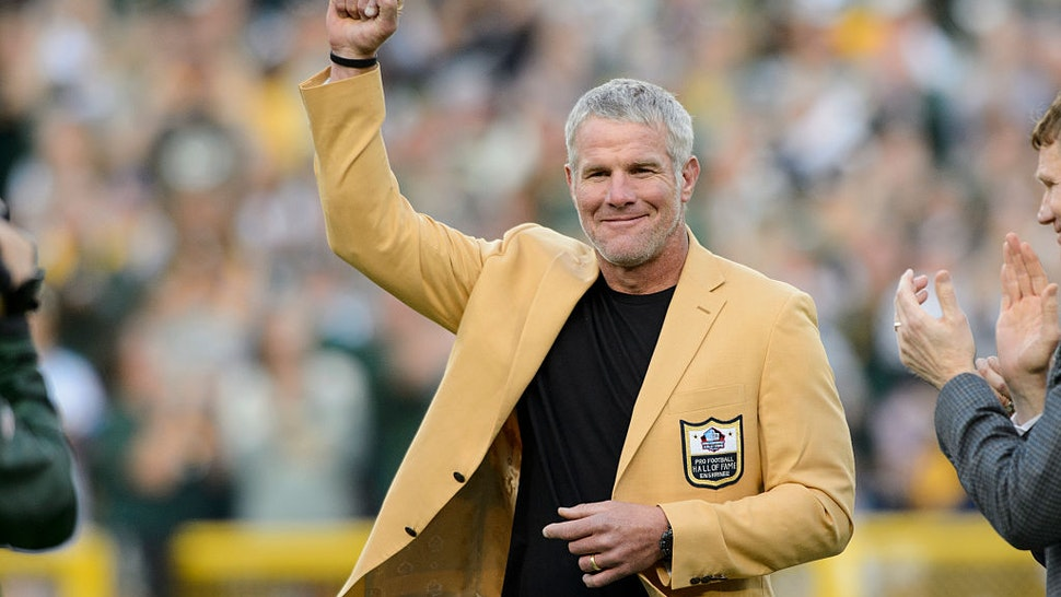 GREEN BAY, WI - OCTOBER 16: Former NFL quarterback Brett Farve looks on as he is inducted into the Ring of Honor during a halftime ceremony during the game between the Green Bay Packers and the Dallas Cowboys on October 16, 2016 at Lambeau Field in Green Bay, Wisconsin. The Cowboys defeated the Packers 30-16. (Photo by Hannah Foslien/Getty Images)