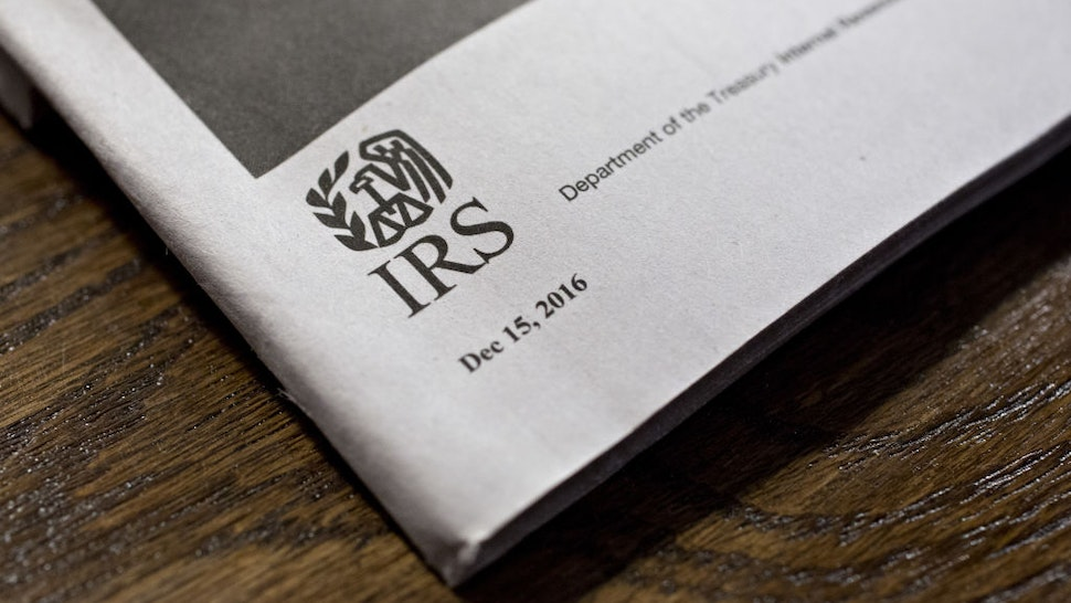 A U.S. Department of the Treasury Internal Revenue Service (IRS) logo is seen on an instruction book for a 1040 Individual Income Tax forms in Tiskilwa, Illinois, U.S., on Tuesday, March 28, 2017. Due to the Emancipation day holiday, this year's income taxes will need to be filed by April 18 instead of April 15. Photographer: Daniel Acker/Bloomberg via Getty Images