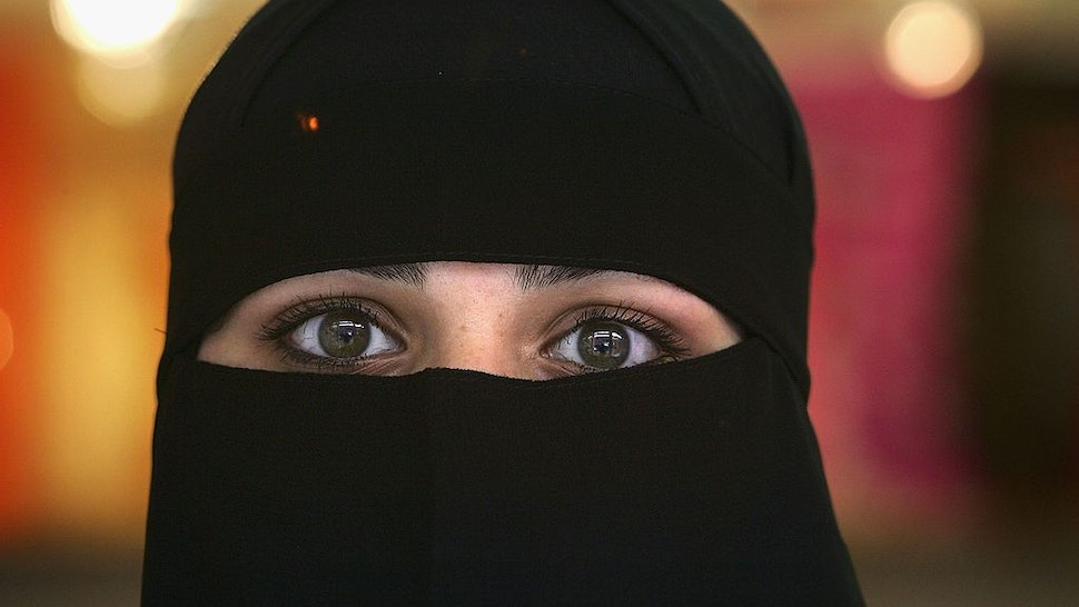 BLACKBURN, UNITED KINGDOM - OCTOBER 06: A Muslim woman wearing a Niqab poses inside an Asian fashion shop in the British northern town of Blackburn, the constituency of Member of Parliament Jack Straw, where a quarter of his constituents are Muslim on October 6, 2006, Blackburn, England. Leader of the House of Commons Jack Straw has said that he asked Muslim women attending his Blackburn constituency surgeries if they would mind removing veils. The comments have caused anger within the Muslim community.
