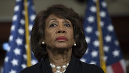 US Representative Maxine Waters (D-CA) looks on before speaking to reports regarding the Russia investigation on Capitol Hill in Washington, DC on January 9, 2018.