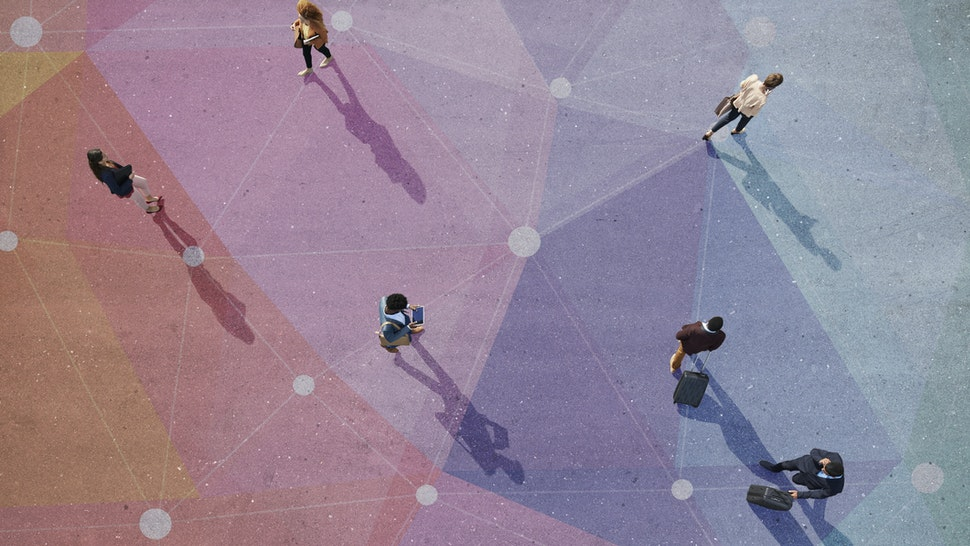 Top view of people walking in different directions of pattern, painted on asphalt - stock photo