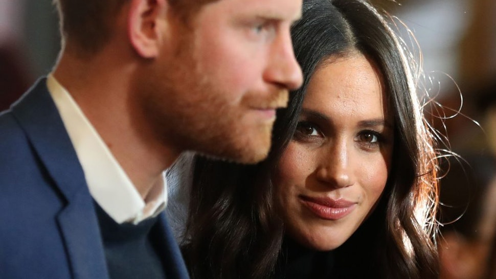 EDINBURGH, SCOTLAND - FEBRUARY 13: Prince Harry and Meghan Markle attend a reception for young people at the Palace of Holyroodhouse on February 13, 2018 in Edinburgh, Scotland.