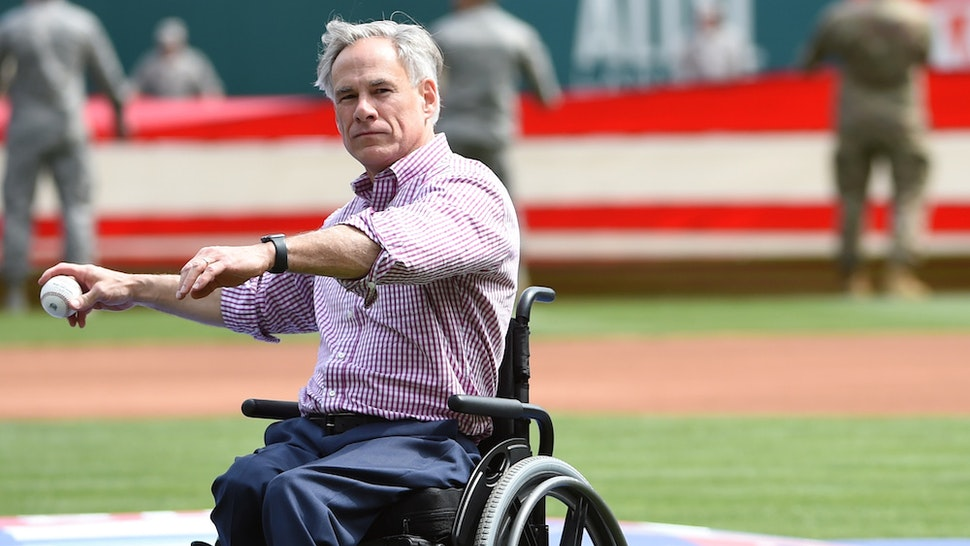 ARLINGTON, TX - MARCH 28: Texas Governor Greg Abbott throws out the ceremonial first pitch before the game between the Chicago Cubs and the Texas Rangers at Globe Life Park in Arlington on Thursday, March 28, 2019 in Arlington, Texas. (Photo by Cooper Neill/MLB Photos via Getty Images)