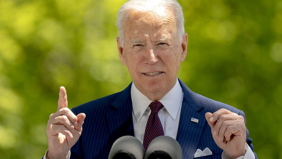 U.S. President Joe Biden speaks on the North Lawn of the White House in Washington, D.C., U.S., on Tuesday, April 27, 2021. Fully-vaccinated Americans can be unmasked when exercising, dining and socializing outdoors in small groups, federal health officials said today, and can gather indoors with other fully vaccinated people and family members without masks or social distancing.