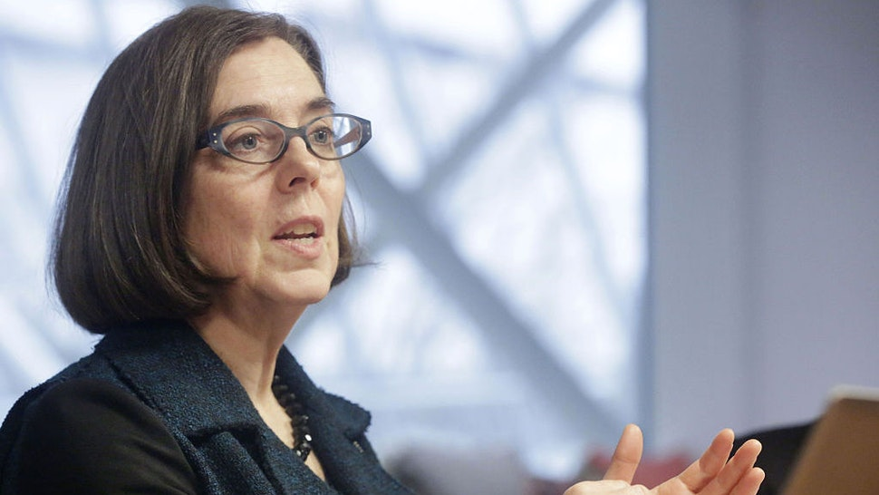 Kate Brown, governor of Oregon, speaks during an interview in Portland, Oregon, U.S. on Wednesday, Jan. 20, 2016. Brown, a Democrat, joined the state House of Representatives in 1991, was later elected to the Senate and served as secretary of state since 2009, before taking over as governor in February. Photographer: Meg Roussos/Bloomberg via Getty Images
