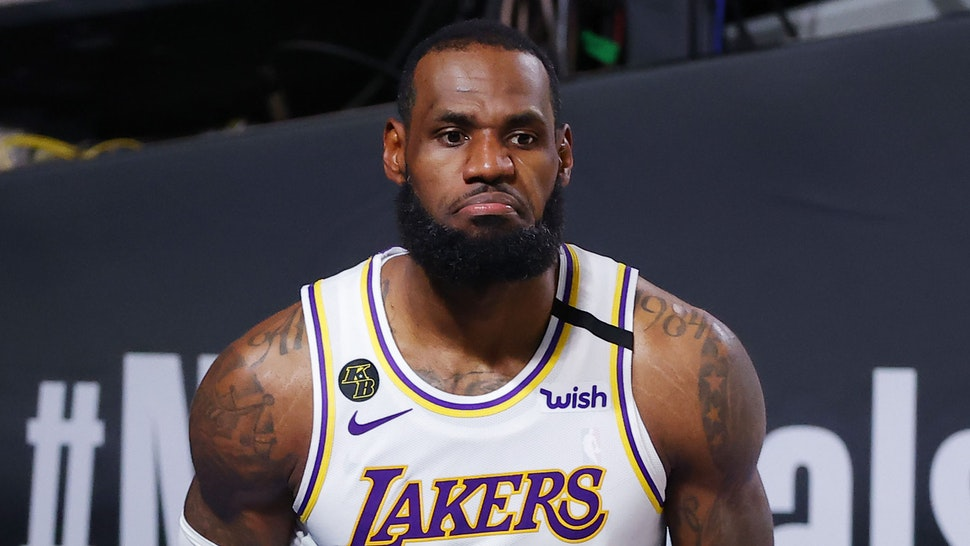 LAKE BUENA VISTA, FLORIDA - OCTOBER 04: LeBron James #23 of the Los Angeles Lakers reacts after being fouled while shooting during the second half against the Miami Heat in Game Three of the 2020 NBA Finals at AdventHealth Arena at ESPN Wide World Of Sports Complex on October 04, 2020 in Lake Buena Vista, Florida.