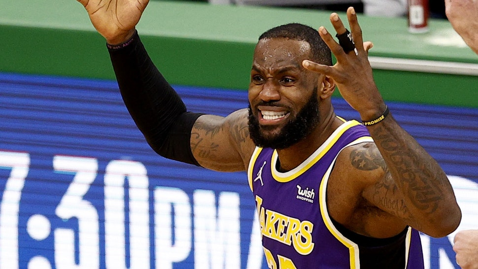 BOSTON, MASSACHUSETTS - JANUARY 30: LeBron James #23 of the Los Angeles Lakers disputes a personal foul called against him during the fourth quarter against the Boston Celtics at TD Garden on January 30, 2021 in Boston, Massachusetts. The Lakers defeat the Celtics 96-95.