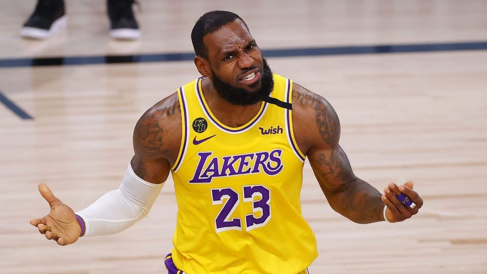 LAKE BUENA VISTA, FLORIDA - OCTOBER 06: LeBron James #23 of the Los Angeles Lakers reacts to a call that was then overturned during the third quarter against the Miami Heat in Game Four of the 2020 NBA Finals at AdventHealth Arena at the ESPN Wide World Of Sports Complex on October 6, 2020 in Lake Buena Vista, Florida.