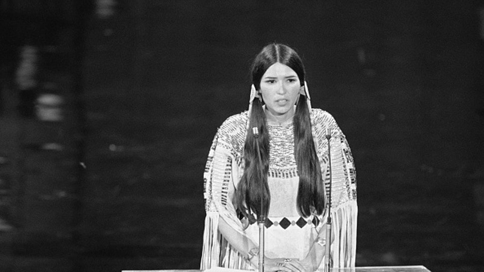 Native American Sacheen Littlefeather speaks at the 45th Academy Awards. On behalf of Marlon Brando, she refused the Best Actor award he was awarded for his role in Godfather. Brando refused the award because of the treatment by the Americans of the American Indian.