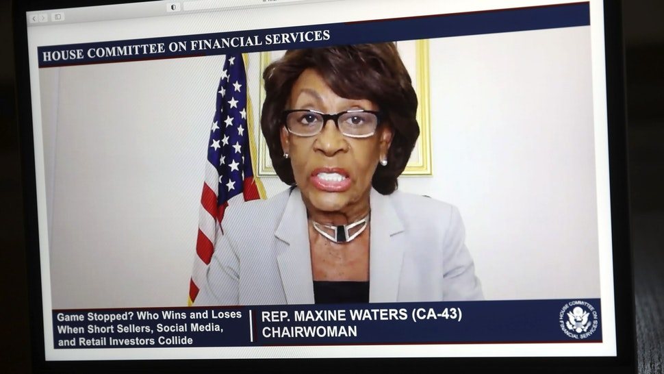 Representative Maxine Waters, a Democrat from California and chairwoman of the House Financial Services Committee, speaks virtually during a hearing on a laptop computer in Tiskilwa, Illinois, U.S., on Thursday, Feb. 18, 2021. Robinhood Markets and Citadel, central players in the GameStop Corp. saga that riveted markets last month plan to deliver a unified message to U.S. lawmakers that conspiracies swirling in Washington, that they worked together to harm retail investors are categorically false.