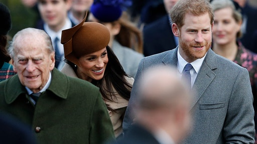 (L-R) Britain's Prince Philip, Duke of Edinburgh, US actress and fiancee of Britain's Prince Harry Meghan Markle and Britain's Prince Harry (R) arrive to attend the Royal Family's traditional Christmas Day church service at St Mary Magdalene Church in Sandringham, Norfolk, eastern England, on December 25, 2017.