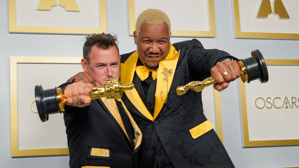 """Martin Desmond Roe, left, and Travon Free, winners of the award for best live action short film for """"Two Distant Strangers"""" pose in the press room at the Oscars on Sunday, April 25, 2021, at Union Station in Los Angeles. (AP Photo/Chris Pizzello, Pool)"""