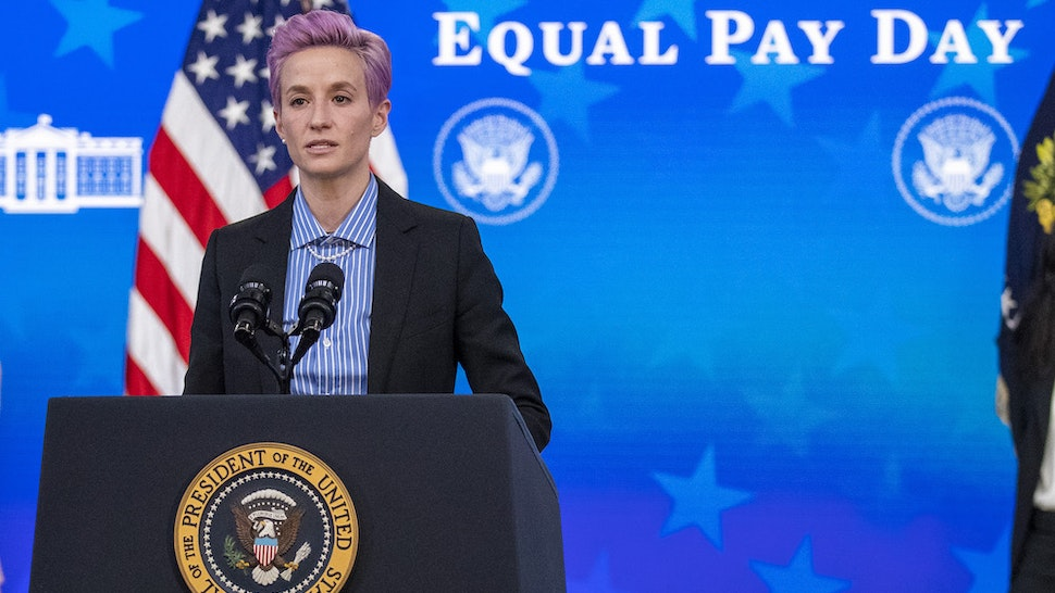 Megan Rapinoe, player with the U.S. Women's National Soccer Team, speaks as U.S. President Joe Biden and First Lady Jill Biden listen during an event marking Equal Pay Day in the Eisenhower Executive Office Building in Washington, D.C., U.S., on Wednesday, March 24, 2021. The Biden administration has signaled plans to strengthen gender equity at a time when women in the U.S. are disproportionately exiting the workforce compared with men during the Covid-19 pandemic, and are paid about 82 cents on the dollar compared with men. Photographer: Shawn Thew/EPA/Bloomberg