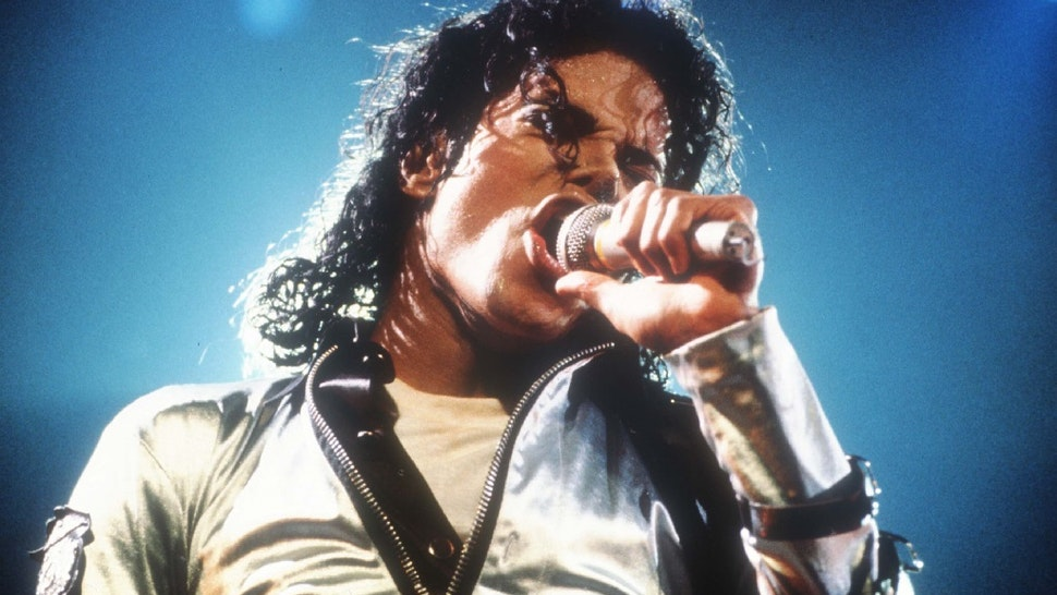 """Entertainer Michael Jackson sings at a concert November 8, 1988 in California. Jackson, who was the lead singer for the Jackson Five by age eight, reached the peak of his solo career with 1982's """"Thriller."""""""