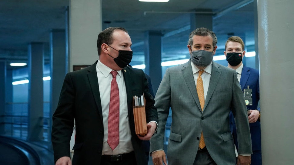 WASHINGTON, DC - FEBRUARY 10: (L-R) Sen. Mike Lee (R-UT) and Sen. Ted Cruz (R-TX) walk through the Senate subway on their way to the second day of former President Donald Trump's second impeachment trial at the U.S. Capitol on February 10, 2021 in Washington, DC. House impeachment managers will make the case that Trump was singularly responsible for the January 6th attack at the U.S. Capitol and he should be convicted and barred from ever holding public office again. (Photo by Drew Angerer/Getty Images)