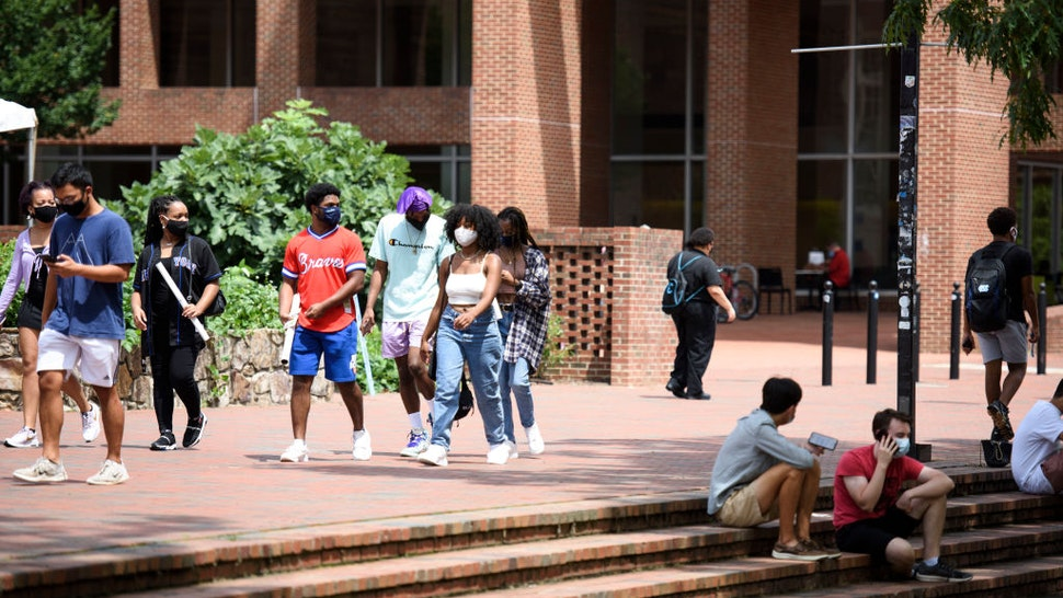 CHAPEL HILL, NC - AUGUST 18: Students walk through the campus of the University of North Carolina at Chapel Hill on August 18, 2020 in Chapel Hill, North Carolina.The school halted in-person classes and reverted back to online courses after a rise in the number of COVID-19 cases over the past week.