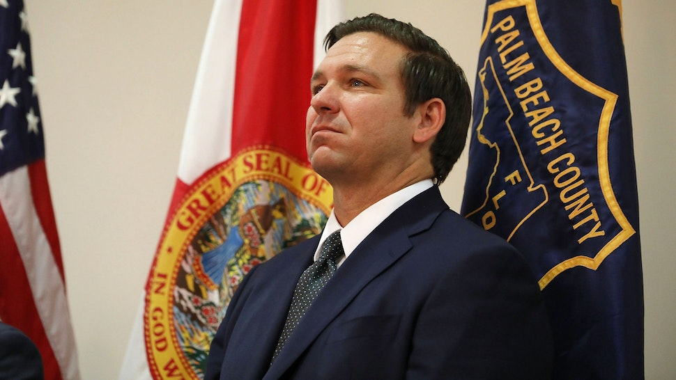 WEST PALM BEACH, FL - OCTOBER 03: Republican candidate for Florida governor Ron DeSantis waits to be introduced during an event put on by the Police Benevolent Association in Palm Beach County on October 3, 2018 in West Palm Beach, Florida. DeSantis is facing off against Democratic challenger Andrew Gillum to be the next Florida governor.