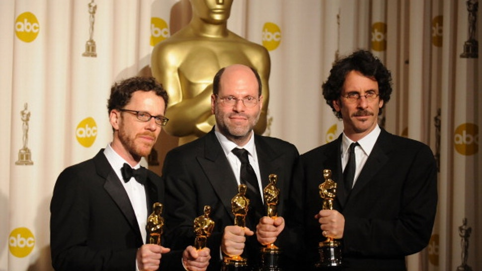 Producers Ethan Coen, Scott Rudin, and Joel Coen poses in the press room during the 80th Annual Academy Awards at the Kodak Theatre on February 24, 2008 in Los Angeles, California.