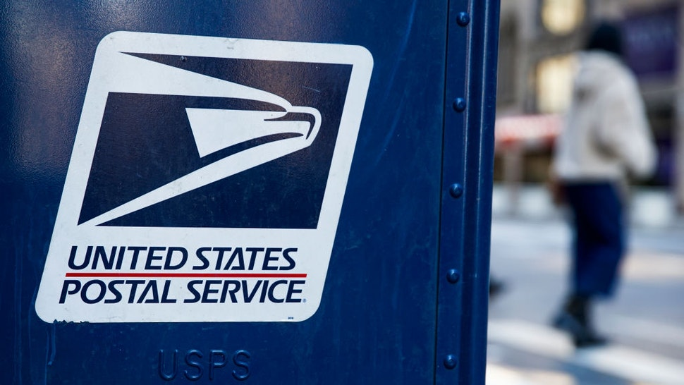 NEW YORK, NEW YORK - FEBRUARY 24: A USPS logo is seen on a mailbox on February 24, 2021, in New York City. The U.S Postal Service awarded a 10-year multi-billion dollar contract to Wisconsin-based Oshkosh Defense to replace its vehicles. (Photo by John Smith/VIEWpress via Getty Images)