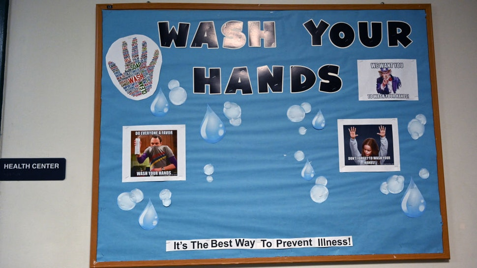 STANDISH, ME - SEPTEMBER 8: A sign outside the nurses office reminds students to wash their hands on the first day of school at Bonny Eagle High School Tuesday, September 8, 2020.
