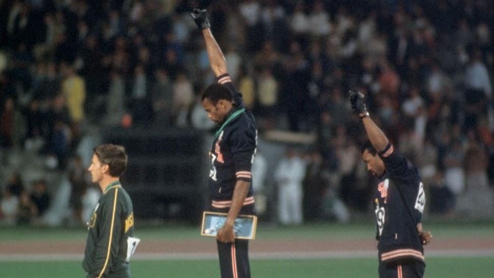 """12-27 OCT 1968: Tommy Smith (307) (1st place) and John Carlos (259) (3rd place) of the US raise their fists in the """"Black Power Salute"""" during the playing of the national anthem at the Olympics in Mexico City, Mexico...Photo: ©"""