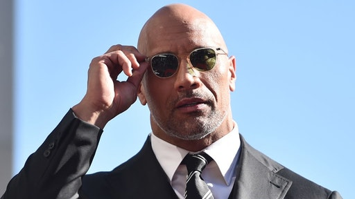 HOLLYWOOD, CA - DECEMBER 13: Actor Dwayne Johnson attends a ceremony honoring him with the 2,624th star on the Hollywood Walk of Fame on December 13, 2017 in Hollywood, California. (Photo by