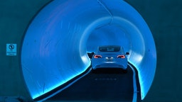 LAS VEGAS, NEVADA - APRIL 09: A Tesla car drives through a tunnel in the Central Station during a media preview of the Las Vegas Convention Center Loop on April 9, 2021 in Las Vegas, Nevada. The Las Vegas Convention Center Loop is an underground transportation system that is the first commercial project by Elon Musk's The Boring Company. The USD 52.5 million loop, which includes two one-way vehicle tunnels 40 feet beneath the ground and three passenger stations, will take convention attendees across the 200-acre convention campus for free in all-electric Tesla vehicles in under two minutes. To walk that distance can take upward of 25 minutes. The system is designed to carry 4,400 people per hour using a fleet of 62 vehicles at maximum capacity. It is scheduled to be fully operational in June when the facility plans to host its first large-scale convention since the COVID-19 shutdown. There are plans to expand the system throughout the resort corridor in the future. (Photo by