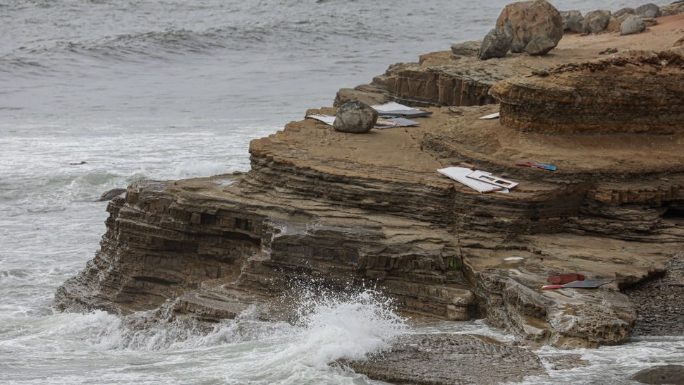 SAN DIEGO, CA - MAY 02: Debris is littered along the shoreline off Cabrillo Monument on May 2, 2021 in San Diego, California. Two people died and Twenty were rescued after a vessel overturned on Sunday afternoon off Point Loma area of San Diego(Photo by Sandy Huffaker/Getty Images)