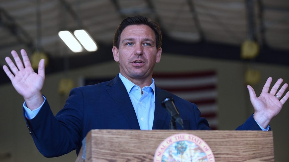 Florida Governor, Ron DeSantis speaks at a press conference at the Eau Gallie High School aviation hangar.
