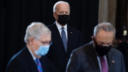 President Joe Biden, Senate Majority Leader Chuck Schumer, D-N.Y., right, and Minority Leader Mitch McConnell, R-Ky., pay respects to U.S. Capitol Police Officer William Billy Evans, as his remains lie in honor in the Capitol Rotunda in Washington, D.C., on Tuesday, April 13, 2021.