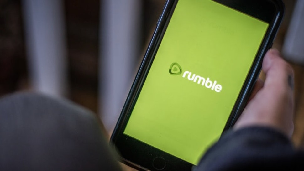 The Rumble video platform logo on a smartphone arranged in Hastings on Hudson, New York, U.S., on Saturday, Jan. 23, 2021. Big tech's decision to ban the Parler app and block former U.S. President Donald Trump is stoking support for alternative social networking sites and apps that bill themselves as promoting free speech and privacy. Photographer: Tiffany Hagler-Geard/Bloomberg via Getty Images