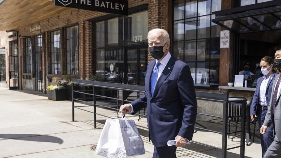 U.S. President Joe Biden wears a protective mask while carrying to-go food at Las Gemelas restaurant in Washington, D.C., U.S., on Wednesday, May 5, 2021. The Biden administration canceled a signature Trump-era rule that would've eased businesses ability to legally consider workers as independent contractors, a rollback the U.S. Labor Department said was necessary to broadly extend wage protections while cracking down on employer abuses. Photographer: Jim Lo Scalzo/EPA/Bloomberg