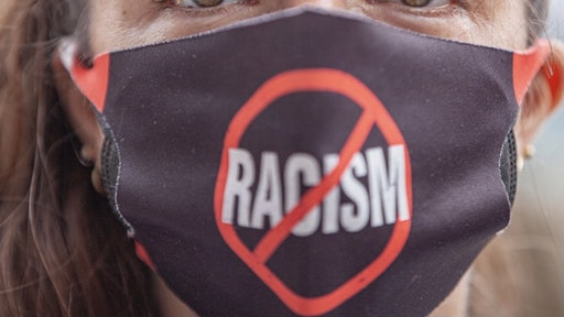 COLUMBUS, OH - APRIL 17: A Black Lives Matter activist wears an anti-racism facial covering at a protest against police brutality in front of the Ohio Statehouse on April 17, 2021 in Columbus, Ohio. Demonstrators gathered in response to multiple recent officer-involved shootings in the U.S. including Miles Jackson, 27, who was fatally shot by Columbus Police in Mount Carmel St. Anns Hospital in Westerville, Ohio on April 12. (Photo by Stephen Zenner/Getty Images)