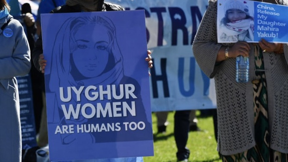"""March 4 Justice Rally Held For Action On Gendered Violence In Parliament CANBERRA, AUSTRALIA - MARCH 15: Protestors attend a rally for the Uyghur community at Parliament House on March 15, 2021 in Canberra, Australia. According to a major new report by a US-based think tank, Beijing is breaching each and every provision of the UN Genocide Convention, with """"intent to destroy"""" the Uyghurs as a group in China's north-western Xinjiang region. The report, published by Newlines Institute for Strategy and Policy, is the first independent expert application of the 1948 Genocide Convention to the ongoing treatment of the Uyghurs in China. (Photo by Sam Mooy/Getty Images)"""