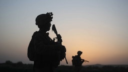 U.S. Marines with the 2nd Marine Expeditionary Brigade, RCT 2nd Battalion 8th Marines Echo Co. step off in the early morning during an operation to push out Taliban fighters on July 18, 2009 in Herati, Afghanistan.
