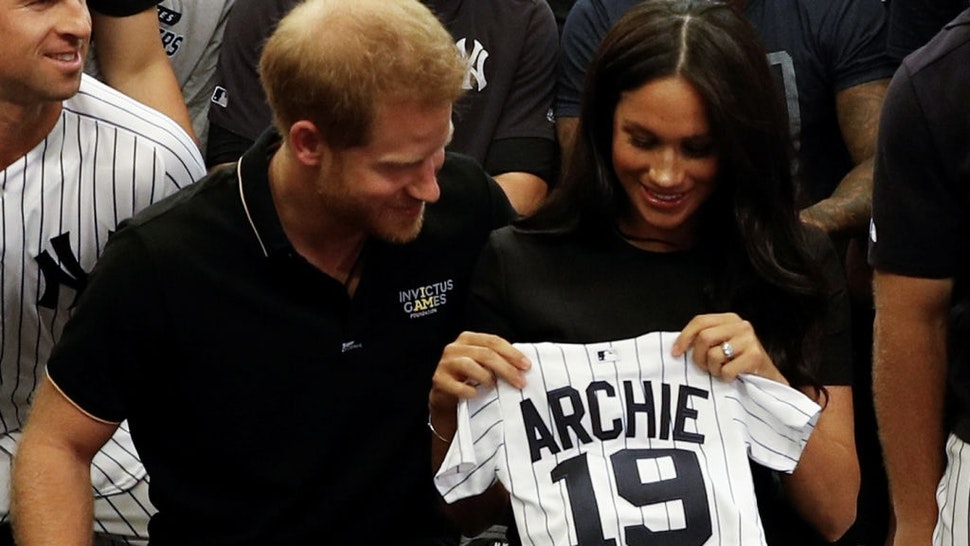 Britain's Prince Harry, Duke of Sussex, and his wife Meghan, Duchess of Sussex react as they are presented with gifts for her newborn son Archie, as they meet New York Yankees players ahead of their match against the Boston Red Sox at the London Stadium in Queen Elizabeth Olympic Park, east London on June 29, 2019, for the first of a two-game Baseball series in London. - As Major League Baseball prepares to make history in London, New York Yankees manager Aaron Boone and Boston Red Sox coach Alex Cora are united in their desire to make the ground-breaking trip memorable on and off the field. (Photo by PETER NICHOLLS / POOL / AFP) (Photo credit should read PETER NICHOLLS/AFP via Getty Images)