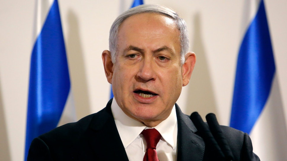 Israeli Prime Minister Benjamin Netanyahu addresses the media at the Defence Ministry in Tel Aviv on November 12, 2019. - Israel's military killed a commander of Palestinian militant group Islamic Jihad in a strike on his home in the Gaza Strip early in the morning, prompting retaliatory rocket fire and fears of a severe escalation in violence.