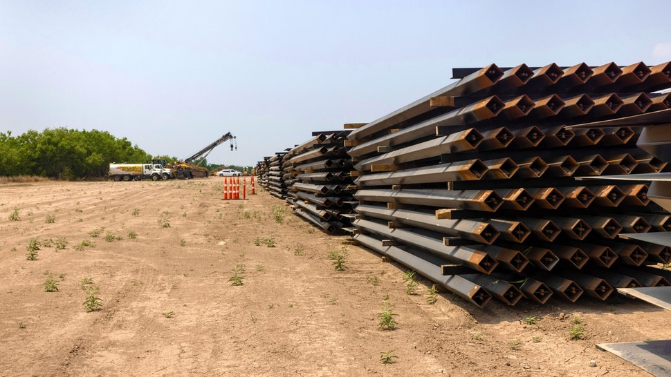 LA JOYA, TEXAS - APRIL 14: Unused pieces of steel bollard-style wall lay near a portion of unfinished border wall at the U.S.-Mexico border on April 14, 2021 in La Joya, Texas. President Joe Biden paused wall construction by executive order upon taking office in January, 2021. The administration has reportedly decided to possibly finish wall construction on gaps where the wall was largely completed.