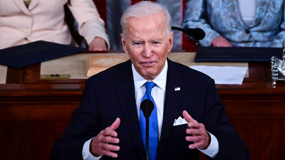 WASHINGTON, DC - APRIL 28: U.S. President Joe Biden addresses a joint session of congress in the House chamber of the U.S. Capitol on April 28, 2021 in Washington, DC. On the eve of his 100th day in office, Biden was to speak about his plan to revive America's economy and health as it continues to recover from a devastating pandemic. He was scheduled to deliver his speech before 200 invited lawmakers and other government officials instead of the normal 1600 guests because of the ongoing COVID-19 pandemic.
