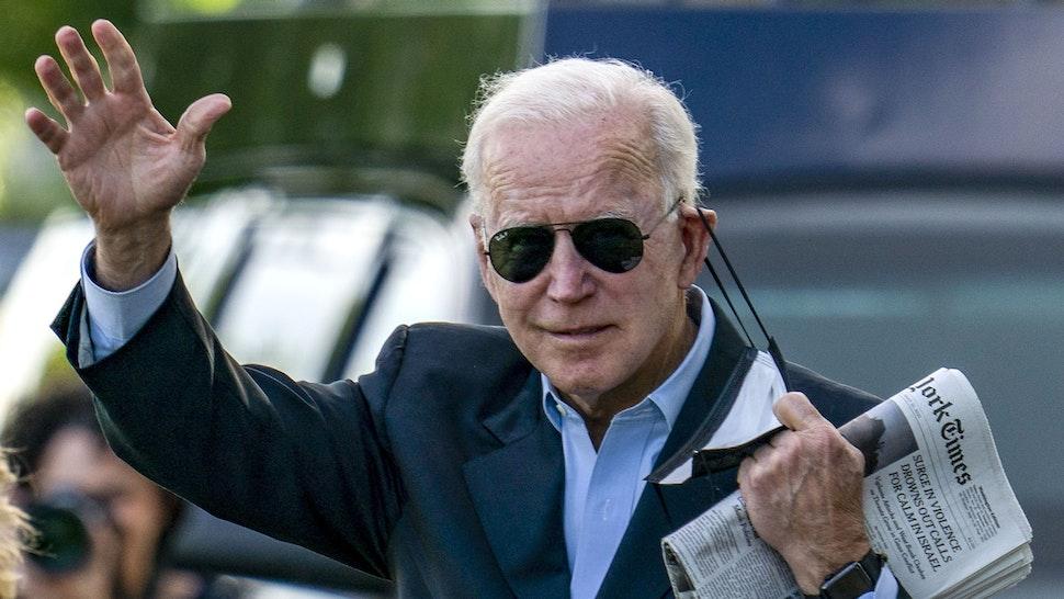 WASHINGTON, DC - MAY 15: First lady Jill Biden and U.S. President Joe Biden walk on the ellipse to Marine One on May 15, 2021 in Washington, DC. The President and the first lady will spend the weekend Wilmington, Delaware.