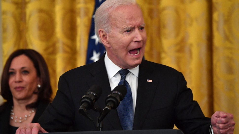 US President Joe Biden speaks before signing the Covid-19 Hate Crimes Act, in the East Room of the White House in Washington, DC on May 20, 2021.