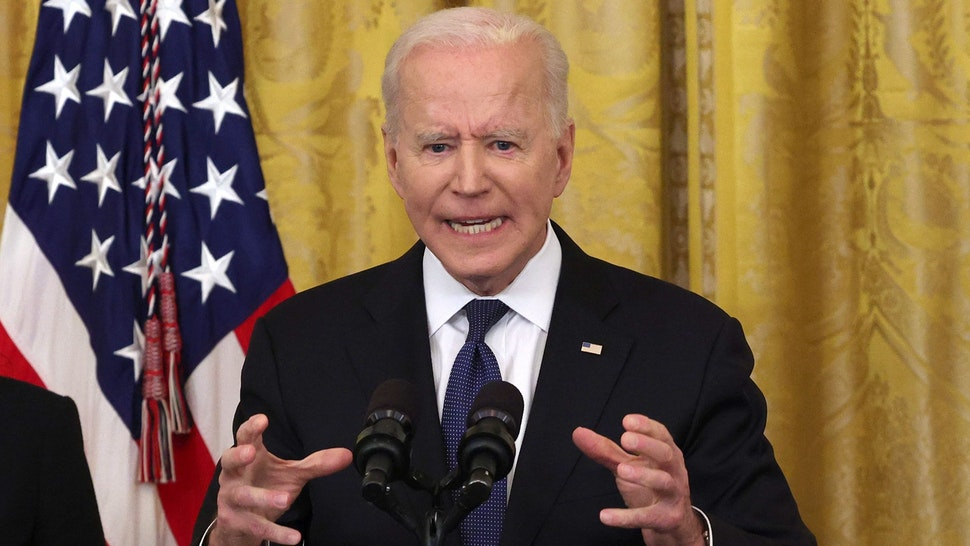WASHINGTON, DC - MAY 20: U.S. President Joe Biden gestures as he delivers remarks, before a signing ceremony for the COVID-19 Hate Crimes Act in the East Room of the White House on May 20, 2021 in Washington, DC. The legislation, drafted in response to the increased violence against the Asian American and Pacific Islander (AAPI) community during the Coronavirus pandemic, will create a new position in the Department of Justice to focus on the rise in hate crimes and provide resources to federal, state, and local jurisdictions to better report cases.
