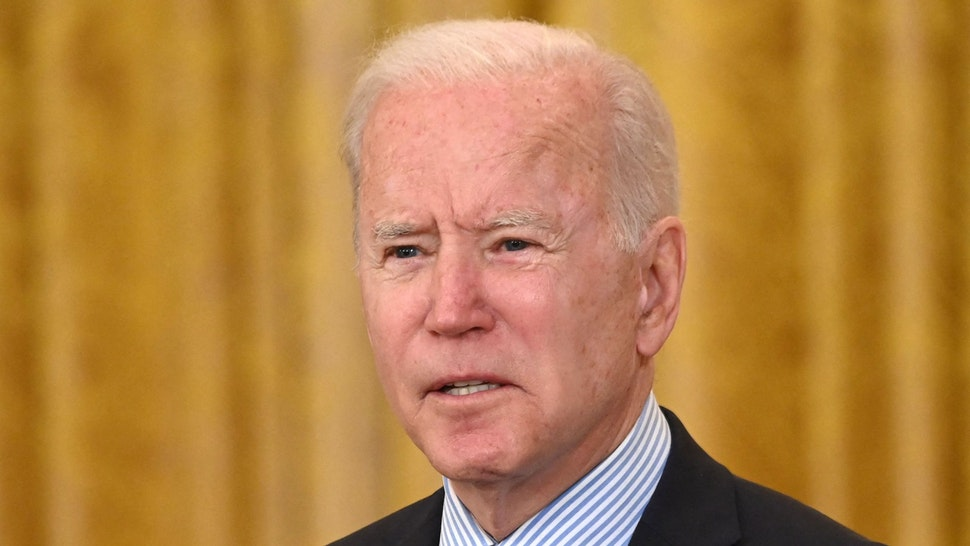 US President Joe Biden speaks about the April jobs report in the East Room of the White House in Washington, DC, on May 7, 2021. - The US economy gained just 266,000 jobs in April and the unemployment rate increased slightly to 6.1 percent, the Labor Department reported, defying expectations for massive rehiring as the Covid-19 pandemic ebbs.