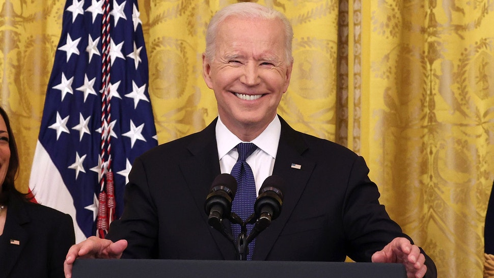 WASHINGTON, DC - MAY 20: U.S. President Joe Biden laughs while giving remarks, as Vice President Kamala Harris looks on, before a signing ceremony for the COVID-19 Hate Crimes Act in the East Room of the White House on May 20, 2021 in Washington, DC. The legislation, drafted in response to the increased violence against the Asian American and Pacific Islander (AAPI) community during the Coronavirus pandemic, will create a new position in the Department of Justice to focus on the rise in hate crimes and provide resources to federal, state, and local jurisdictions to better report cases.
